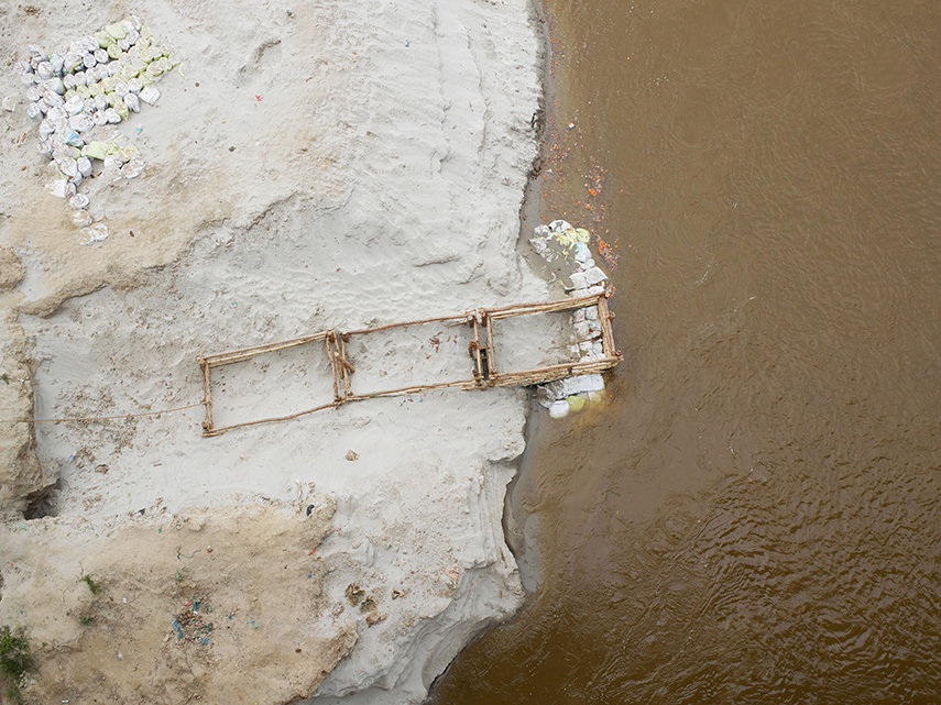 Cement bag weightings in the River Ganges