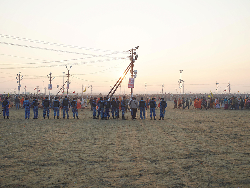 Police control massed crowds at the Sangam main bathing area, sunrise February 10th, main bathing day